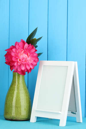 White photo frame for home decoration on blue background Stock Photo - 17820788