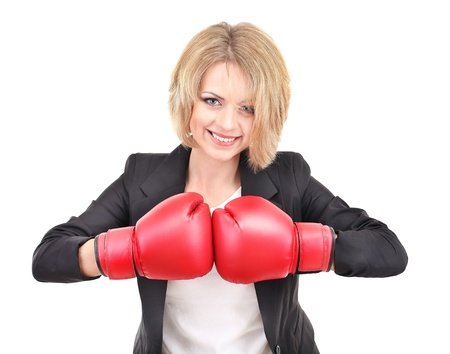 Young beautiful business woman with boxing gloves isolated on white Stock Photo - 21539905