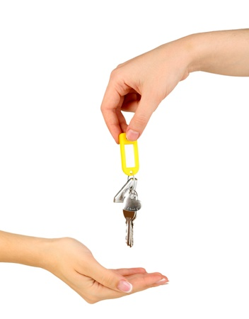 Transfer of house keys isolated on white photo