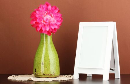 White photo frame for home decoration on brown background Stock Photo - 17834065
