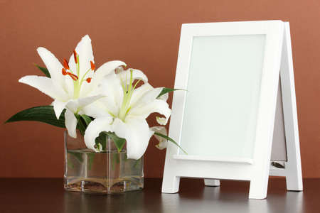 White photo frame for home decoration on brown background Stock Photo - 17834069