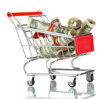 shopping trolley with dollars, isolated on white Stock Photo - 17865673