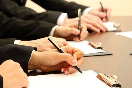 workteam: Close up of business people hands during teamwork Stock Photo