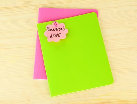Sticker-reminder with most popular password, on notebook, on wooden background Stock Photo - 17866029