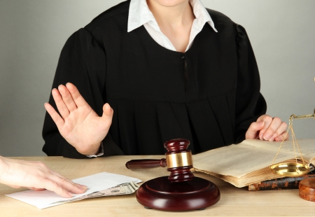 Judge sitting at table during court hearings on grey background Stock Photo - 17865939