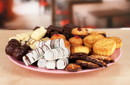 Sweet cookies on plate on table in cafe Stock Photo - 17866737