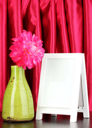 White photo frame for home decoration on curtains background Stock Photo - 17865930