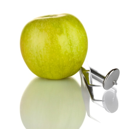 Green apple and dental tools isolated on white Stock Photo - 17884303