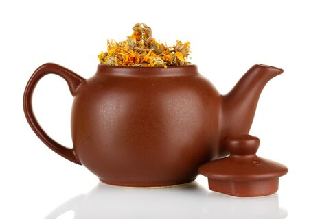 nontraditional: Dried herbs in teapot, isolated on white. Conceptual photo of herbal tea.
