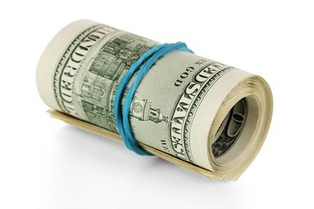 Twisted bundle 100 dollar bills isolated on white Stock Photo - 17887552