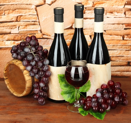 Composition of wine, wooden barrel and  grape, on stone background Stock Photo - 17887923