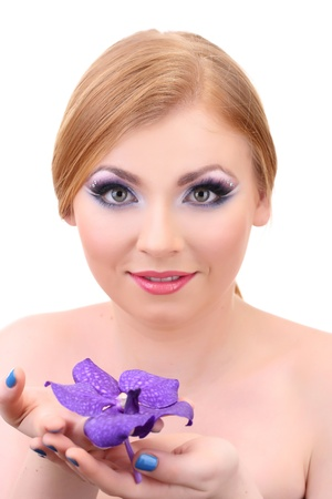 Portrait of beautiful young woman with glamour make up and flower, isolated on white photo