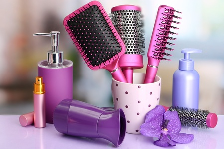 Hair brushes, hairdryer and cosmetic bottles in beauty salon  Stock Photo - 17887026