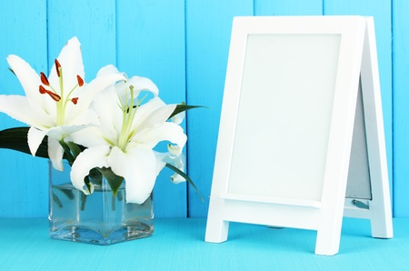 White photo frame for home decoration on blue background Stock Photo - 17887831