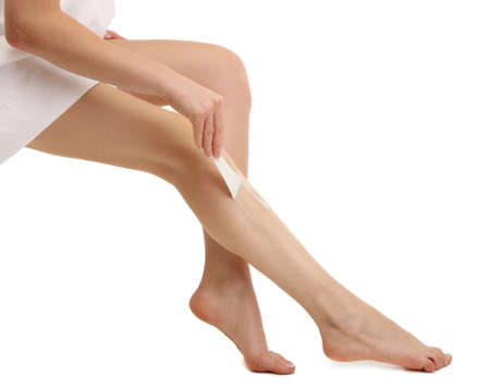 Beautiful woman legs with depilation cream, isolated on white photo
