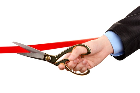 Cutting red ribbon, isolated on white Stock Photo - 17970427