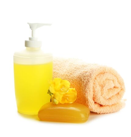 Bottle, soap and towel, isolated on white photo