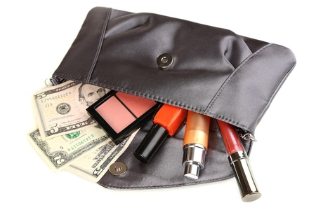 Items contained in the women's handbag isolated on white Stock Photo - 17978958