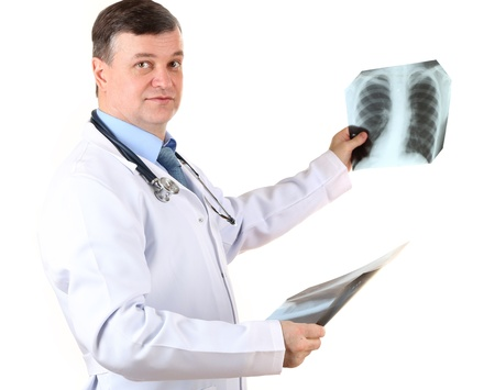 Medical doctor analysing x-ray image  isolated on white Stock Photo - 21540664