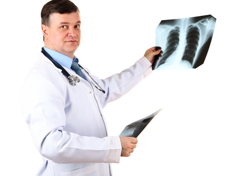 Medical doctor analysing x-ray image  isolated on white Stock Photo - 21540680
