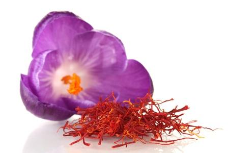 Beautiful purple crocus and saffron, isolated on white photo