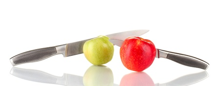 Red, green apples with knives isolated on white