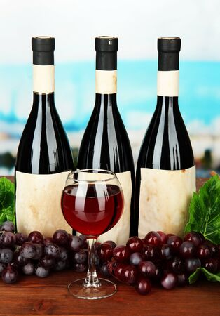 Composition of wine bottles, glass and  grape, on bright background Stock Photo - 18038973