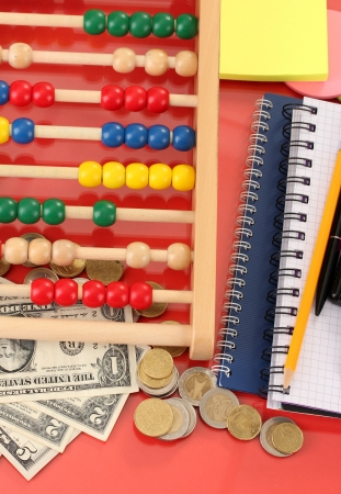 Bright wooden abacus and calculator. Conceptual photo of old and modern business photo