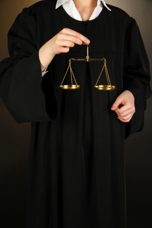 Judge on black background photo