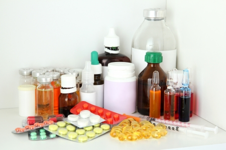 Medical bottles and pills on shelf Stock Photo - 18038839