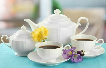 porcelain flower: Beautiful tea service on table