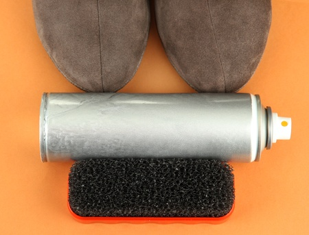 Set of stuff for cleaning and polish shoes, on color background Stock Photo - 18039004