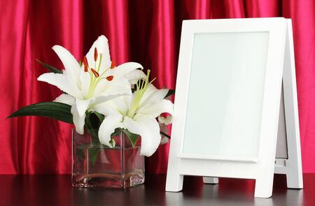White photo frame for home decoration on curtains background Stock Photo - 18038812
