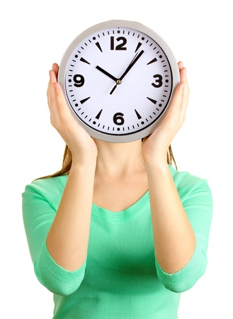 Girl holding clock over face isolated on white photo
