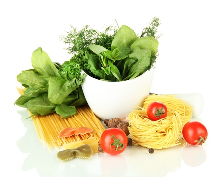 Composition of mortar, pasta and green herbals, isolated on white photo