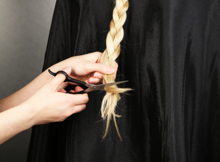 Haircut blond hair on grey background photo