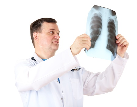 Medical doctor analysing x-ray image  isolated on white Stock Photo - 21540811