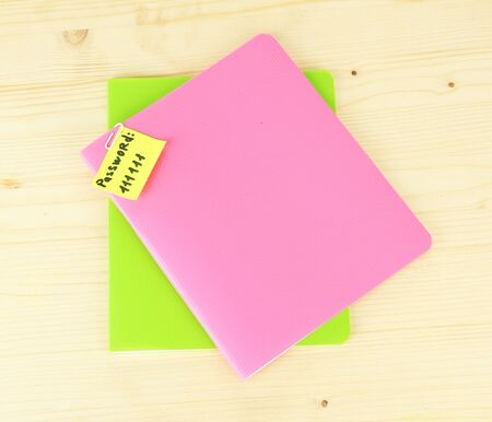 Sticker-reminder with most popular password, on notebook, on wooden background Stock Photo - 18038829