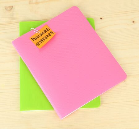 Sticker-reminder with most popular password, on notebook, on wooden background Stock Photo - 18038732