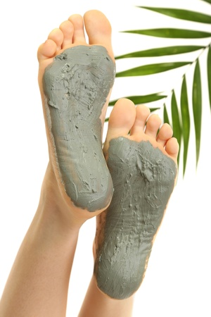 mud girl: Woman foots with cosmetics, isolated on white