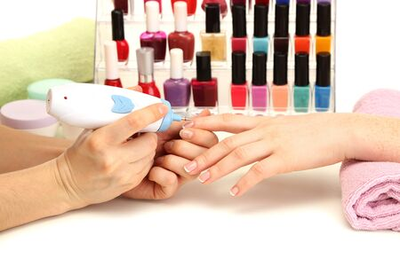Manicure process in beauty salon, close up photo