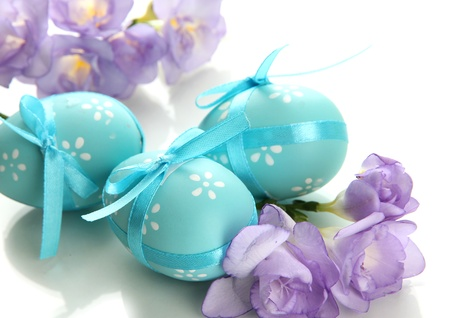 painted eggs: Bright easter eggs with bows and flowers, isolated on white