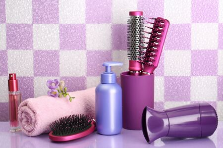 Hair brushes, hairdryer and cosmetic bottles in bathroom Stock Photo - 18042879
