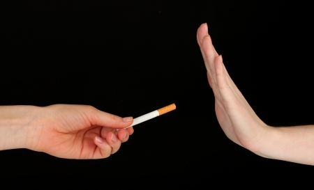 quit: Concept: stop smoking, on black background Stock Photo