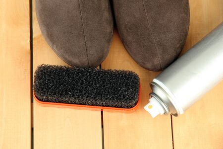 Set of stuff for cleaning and polish shoes, on wooden background Stock Photo - 18042960