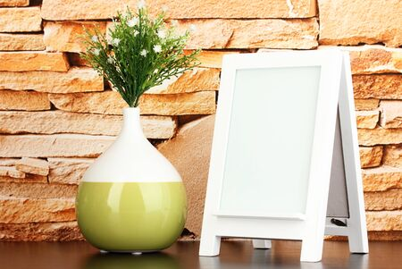 White photo frame for home decoration on stone wall background Stock Photo - 18042880