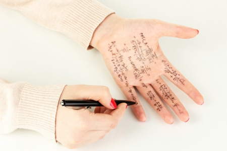 Write cheat sheet on hand isolated on white Stock Photo - 18042755