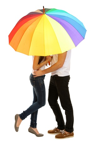 Loving couple standing with umbrella isolated on white photo