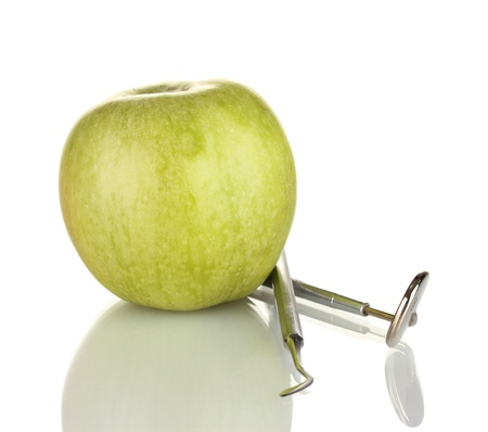 Green apple and dental tools isolated on white Stock Photo - 18141358