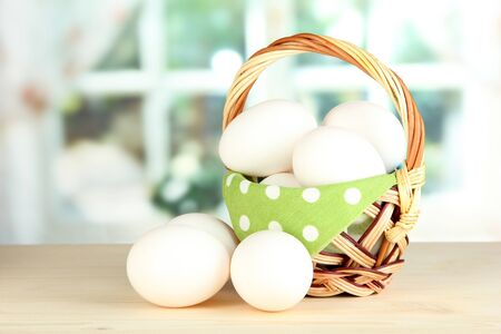Many eggs in basket on table in room Stock Photo - 18142366
